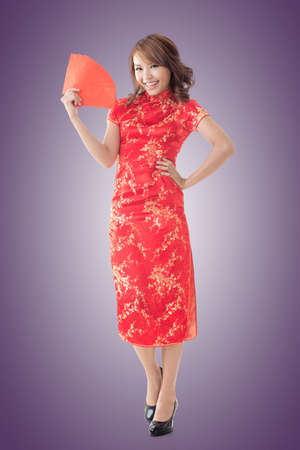 chipao: Attractive Chinese woman dress traditional cheongsam and hold red envelope, closeup portrait.