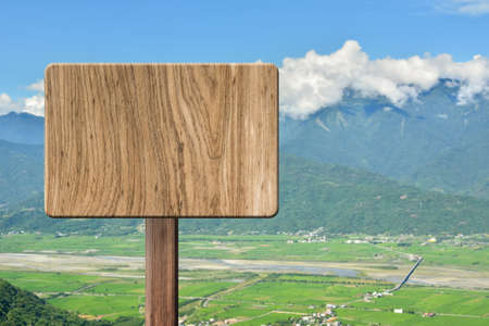 heave: Blank wooden sign on field of farm. Concept of rural, idyllic, tranquility etc. Stock Photo