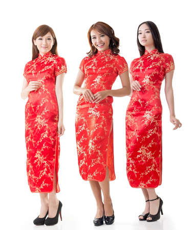 chipao: Group of Chinese women dress traditional cheongsam at New Year, studio shot isolated on white background. Stock Photo