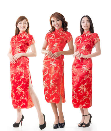 qipao: Group of Chinese women dress traditional cheongsam at New Year, studio shot isolated on white background. Stock Photo