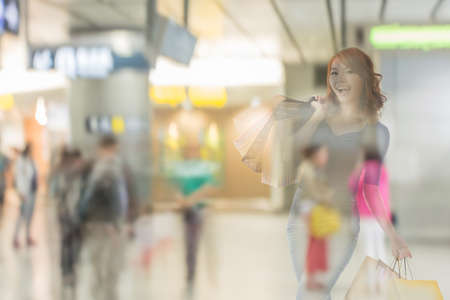 asian shopper: double exposure of shopping woman in the mall.