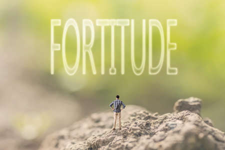 braveness: one person stand in the outdoor and looking up text on nature background, concept of courage Stock Photo