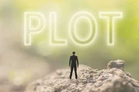 Concept of plan with a person stand in the outdoor and looking up the text over the sky in nature background. Stock Photo