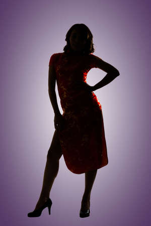 Silhouette of Chinese woman dress traditional cheongsam at New Year, studio shot isolated. photo