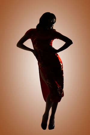 chipao: Silhouette of Chinese woman dress traditional cheongsam at New Year.