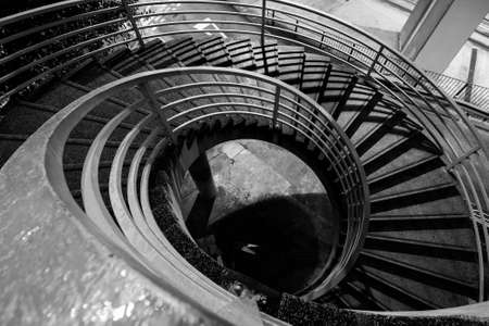spiral stairs: Stairs in black and white in the outside of a modern city.