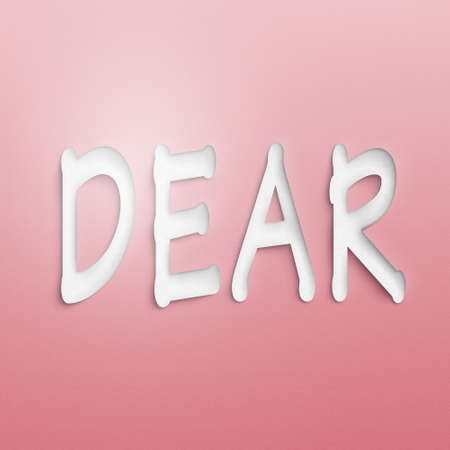 dear: text on the wall or paper, dear Stock Photo