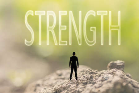 creative strength: one person stand in the outdoor and looking up the text on nature background, concept of power, strength, force. Stock Photo
