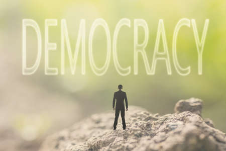 referendum: Concept of democracy with a person stand in the outdoor and looking up the text over the sky in nature background.