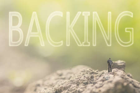 backing up: Concept of assist with a person stand in the outdoor and looking up the text over the sky in nature background.