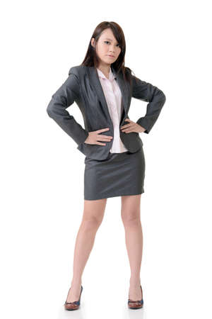 supercilious: Confident business woman of Asian, full length portrait on white background. Stock Photo
