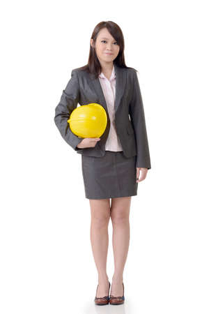 young engineer: Business woman holding hat, full length portrait on white background. Stock Photo