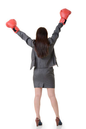 exciting: Exciting gloved business woman on white background.