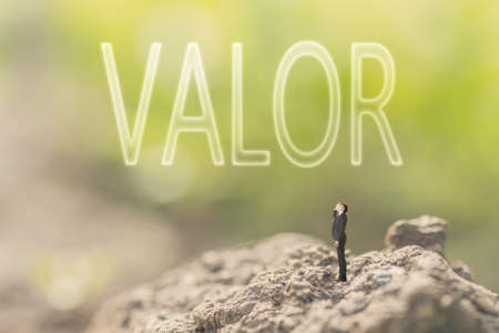 one person stand in the outdoor and looking up text on nature background, concept of courage Stock Photo