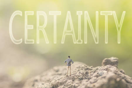 certainty: Concept of faith with a person stand in the outdoor and looking up the text over the sky in nature background.