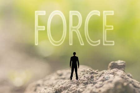 force of the nature: one person stand in the outdoor and looking up the text on nature background, concept of power, strength, force. Stock Photo
