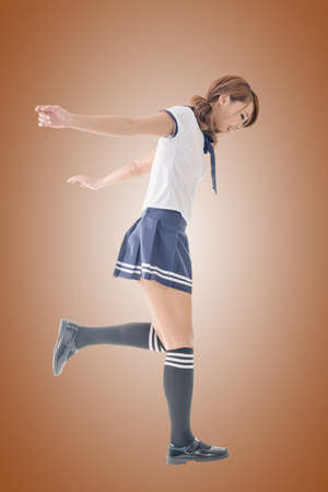 chinese lady: Japanese style school girl in sailor suit, full length portrait. Stock Photo