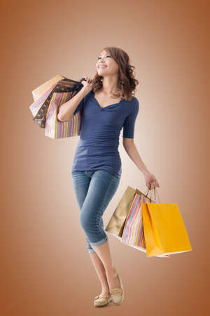 asian lady: Cheerful shopping woman of Asian holding bags. Stock Photo