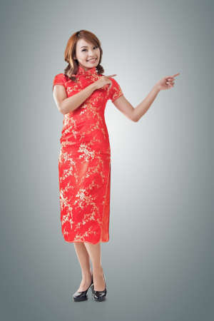 chipao: Chinese woman dress traditional cheongsam at New Year and introducing, full length portrait isolated.