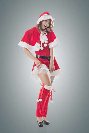 christmas christmas christmas: Attractive Christmas lady of Asian woman, full length portrait. Stock Photo