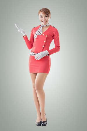 flight attendant: Asian flight attendant portrait, full length isolated. Stock Photo