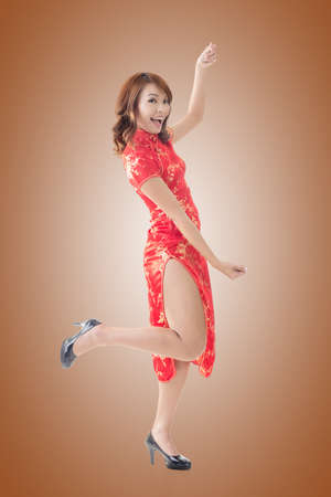 instruction sheet: Attractive Chinese woman dress traditional cheongsam and hold something, full length portrait. Stock Photo