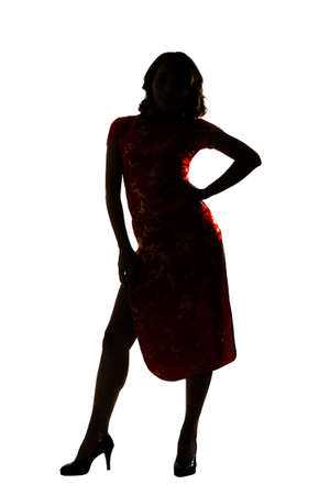 woman looking: Silhouette of Chinese woman dress traditional cheongsam at New Year, studio shot isolated.
