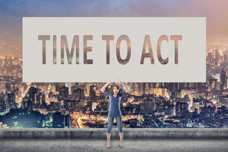 urgent announcement: Time to act, words on blank board hold by a young girl in the outdoor. Stock Photo