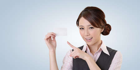 chinese people: Cheerful business woman holding blank business card, closeup portrait   Stock Photo