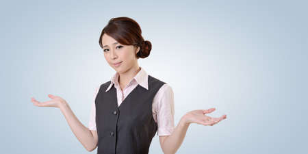 helpless: Helpless young business woman shrugs her shoulders. closeup portrait with clipping path.
