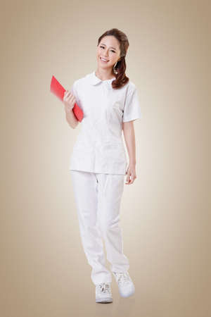asian nurse: Attractive Asian nurse, woman portrait.Full length. Stock Photo