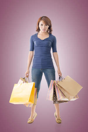 lifestyle shopping: Confident shopping woman of Asian holding bags, isolated. Stock Photo