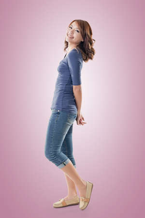 young asian: Excited Asian young girl, full length portrait isolated.
