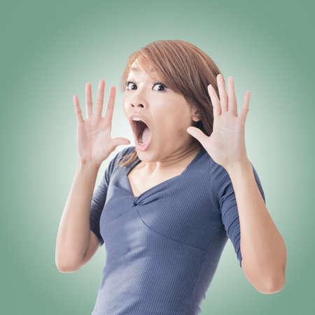 funny face: Surprised Asian woman, closeup portrait.