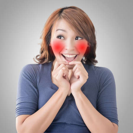 glad: Emoji face expression of an Asian woman.
