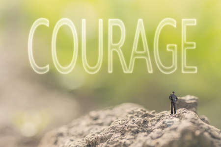 spunk: one person stand in the outdoor and looking up text on nature background, concept of courage Stock Photo