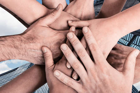 conept: Group of hands holding together, conept of all, team, together etc.