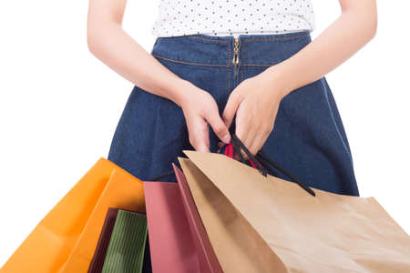 concept images: Concept of woman shopping and holding bags, closeup images.