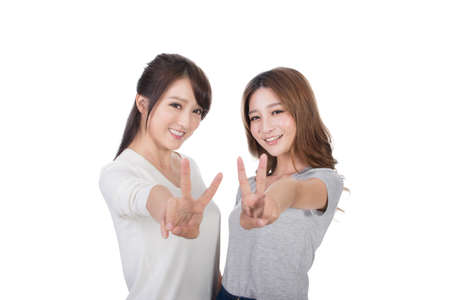 victory symbol: Asian women give you a sign of victory. Stock Photo