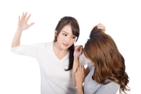 girl fight: Asian women fight and pull hair. Stock Photo