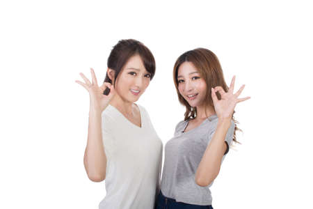 a ok: Asian women give you a sign of okay.