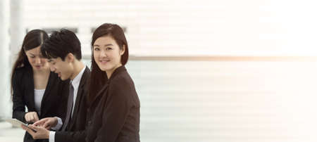 Business team of Asian in the city of Hong Kong, closeup portrait with shallow depth of focus.