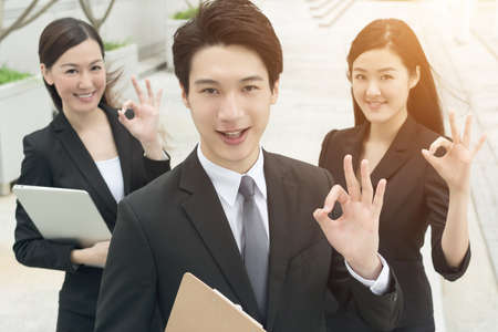 asian: Successful business man with his young team partner in Hong Kong. Stock Photo