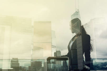 future business: Silhouette of businesswoman stand and look far away in Hong Kong, Asia. Double exposure. Stock Photo