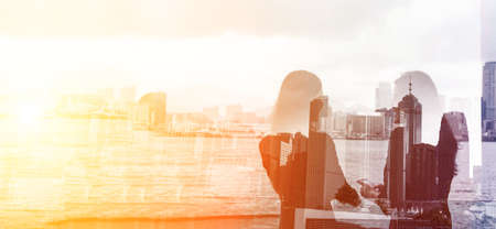 copyspace: Silhouette of two businesswomen stand and look far away in Hong Kong, Asia. Double exposure.