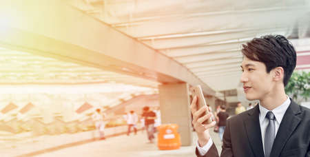 success man: Confident young Asian businessman using cellphone, concept of business, technology, social media etc. Stock Photo