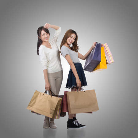 lifestyle shopping: Happy smiling shopping girls of Asian holding bags with her friends. Stock Photo