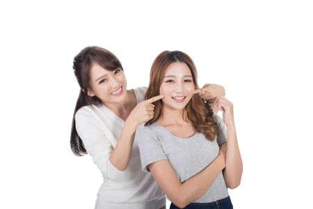 pretty face: Asian woman with her friend, studio shot portrait.