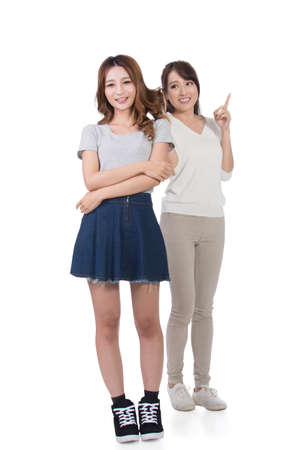 young friends: Asian woman with her friend, studio shot portrait.