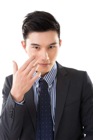 young male: holding something on face, closeup portrait of Asian businessman